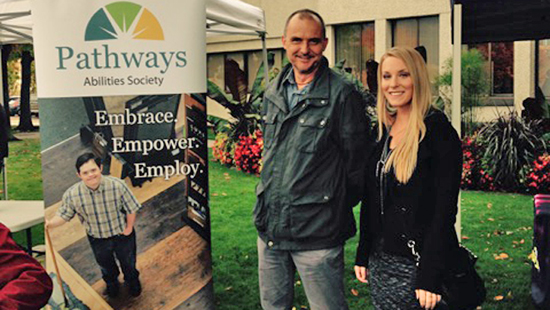 CLBC staff members Tom Myatt and Denai Christenson join the Community Living Month celebrations in Kelowna.