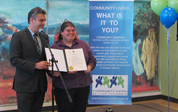 Mayor Richard Atwell presents Saanich's proclamation of Community Living Month to Jennifer Deakin, a member of the CLBC South Island Community Council.