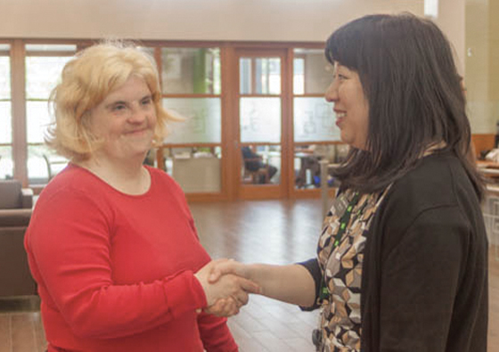 Aine Rathwell, self advocate and TD customer, speaks with TD's Coal Harbour Branch Manager Helen Yee about her banking needs.