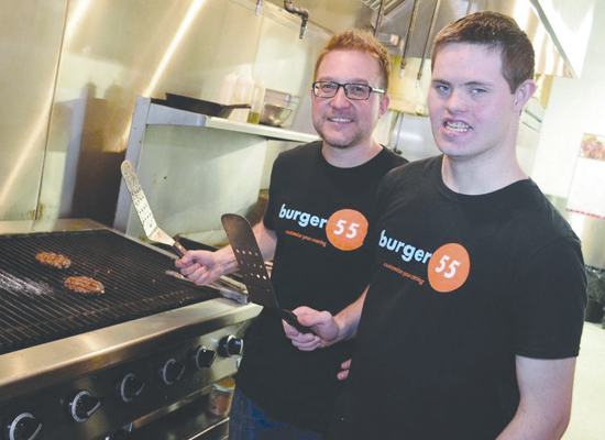 Kevin Speijer (right) with Chris Boehm, the owner of Burger 55, is one of many employment success stories from across BC.