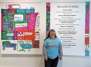 "Teresa stands in front of her ""We Love it Here"" poem and artwork, exhibited at Gallery Gachet in June 2016. The artwork and poems are featured in her Pretty Amazing book. Photo by Franke James"