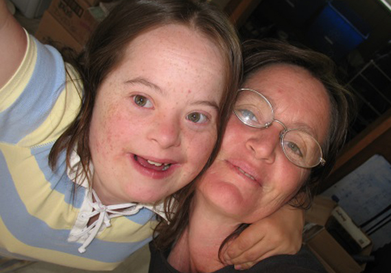 Art graduate Kari Burk (right) wrote and illustrated Snapshot of a Soul Space in the land of special needs to chronicle her 25-year journey with daughter Mielle.