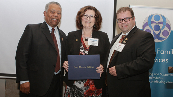 Paul Harris Fellow Edwina Jeffrey receives award from Rotary Club of Surrey past president John Edwards (left) and current president Ed Landry.