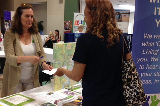 Jocelyn Geidt, facilitator in CLBC's South Island CPD office, share information with guests at the Sidney Access Awareness Day Resource Fair.